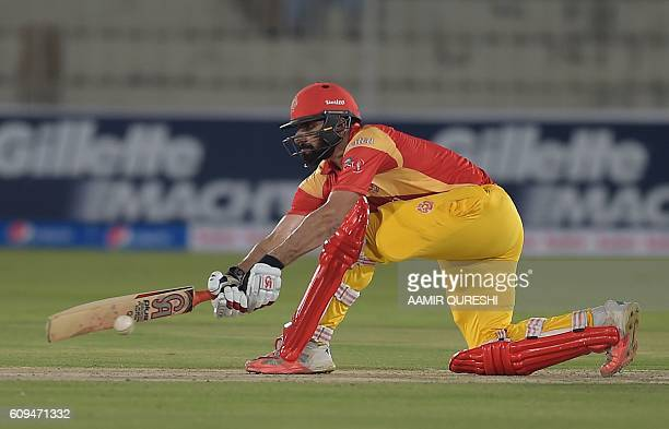 Pakistani captain MisbahulHaq of Islamabad United plays a shot during an exhibition match at Rawalpindi Cricket stadium in Rawalpindi on September 20...