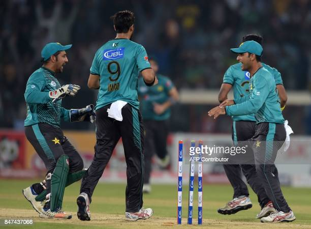 Pakistani captain Sarfraz Ahmad celebrates with teammates after the dismissal of World XI batsman Hashim Amla during the third and final Twenty20...