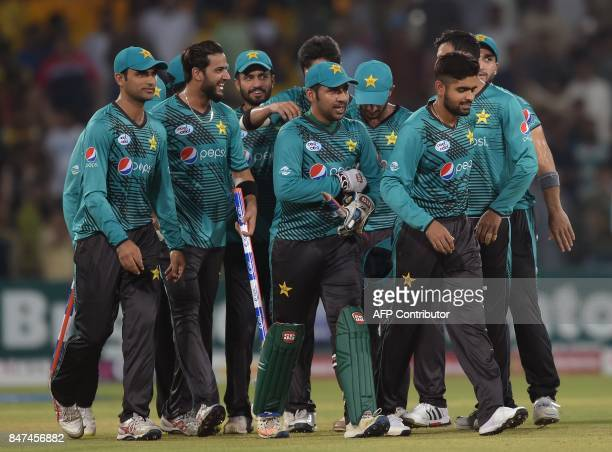 Pakistani captain Sarfraz Ahmad celebrates with teammates as they walk back to pavilion after winning the third and final Twenty20 International...
