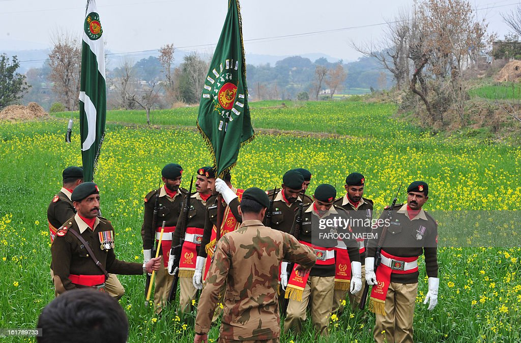 Pakistani ceremonial guard soldiers arrive for a funeral ceremony of a soldier who was shot dead along the Line of Control (LoC), at a village in Bainso, about 45 kms from the capital Islamabad, on February 16, 2013. Indian troops shot dead a Pakistani soldier along the de facto border in the disputed Kashmir region in the first deadly exchange since a truce was agreed a month ago, officials said Friday. AFP PHOTO/Farooq NAEEM