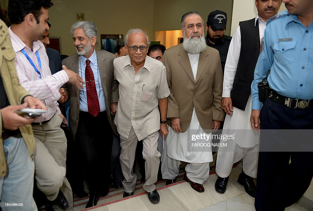 Pakistani Chief Election Commissioner Fakhruddin G. Ibrahim (C) arrives to announce the name of caretaker Prime Minister at his office in Islamabad on March 24, 2013. Ibrahim announced the name of Mir Hazar Khan Khoso as caretaker Prime Minister for the upcoming elections. AFP PHOTO/ Farooq NAEEM