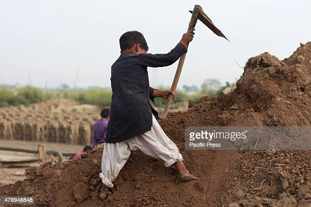 Pakistani child labourer busy in work at a brick kiln in Lahore as world marked the World Day Against Child Labor This year the World Day against...