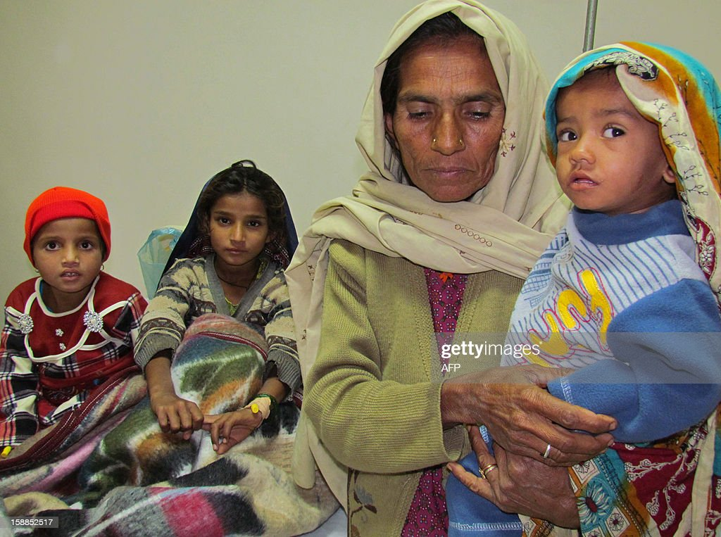Pakistani children suffering from measles rest at a Red Cross hospital in the southern Sindh province city of Sukkur on January 1, 2013. More than 300 Pakistani children died of measles last year, a staggering increase on the previous 12 months and a result of three consecutive years of flooding, officials said. The United Nations' World Health Organization said 306 children died of the highly infectious illness last year, 210 of them in the southern province of Sindh, where the worst floods occurred in 2010, 2011 and 2012.