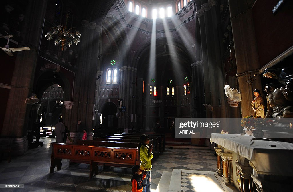 Pakistani Christian children pray after the memorial service for slain Christian minister Shahbaz Bhatti at The Heart Cathedral Church in Lahore on...