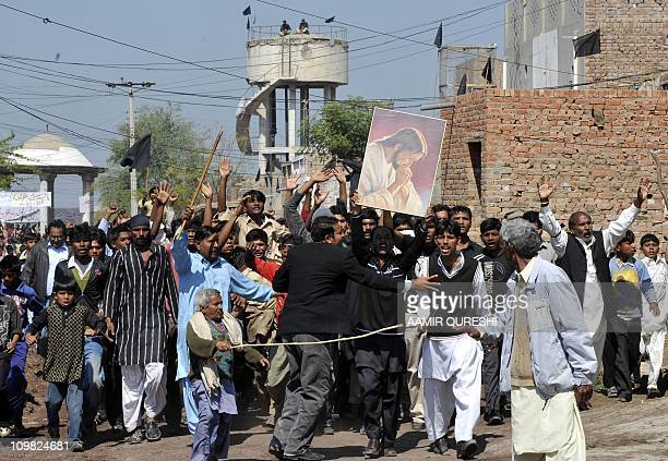 Pakistani Christian mourners march and shout slogans against the killing of slain Pakistani minister for minorities Shahbaz Bhatti during the funeral...