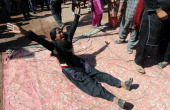 A Pakistani Christian mourns as she shouts slogans against the killing of slain Pakistani minister for minorities Shahbaz Bhatti during the funeral...
