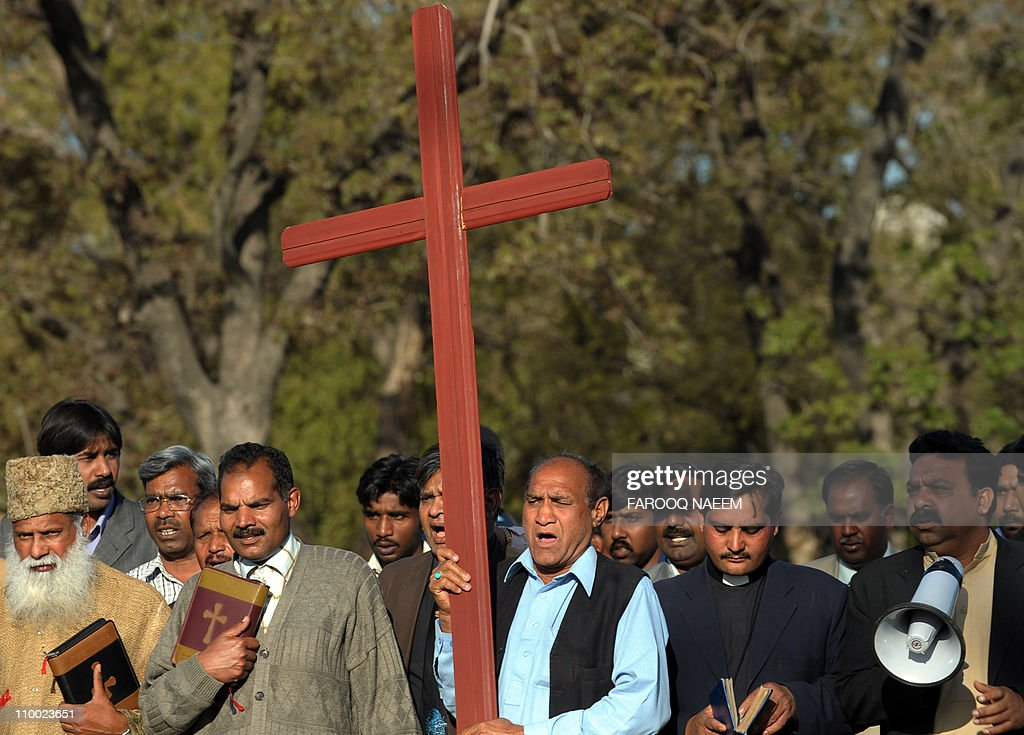 Pakistani Christian priests march during a rally in Islamabad on March 12 against the killing of Pakistan's Minority affairs minister Shahbaz Bhatti...