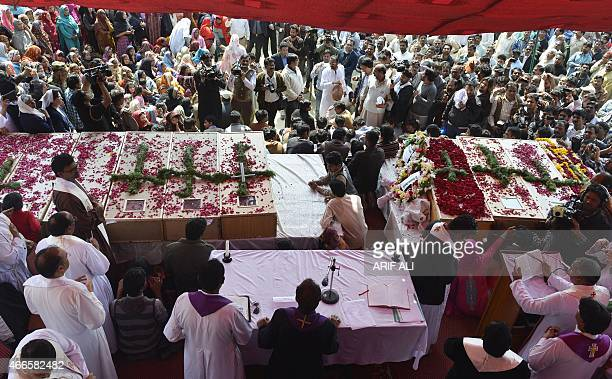 Pakistani Christians attend a funeral ceremony for those killed in suicide bomb attacks on churches in Lahore on March 17 2015 Pakistani Christians...