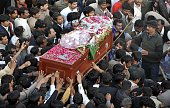 Pakistani Christians bury the coffin of slain minister for minorities of Pakistan Shahbaz Bhatti in the family graveyard in his native village of...