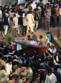 Pakistani Christians carry the coffin of slain minister for minorities of Pakistan Shahbaz Bhatti to be buried in the family graveyard in his native...