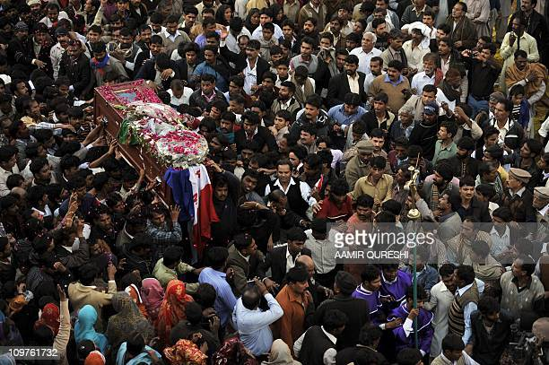Pakistani Christians carry the coffin of slain minister for minorities of Pakistan Shahbaz Bhatti to the burial grounds in his native village of...