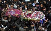 Pakistani Christians carry the coffin of their slain leader and minister for minorities Shahbaz Bhatti for burial at his family graveyard in his...