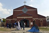 Pakistani Christians gather in front of a church following suicide bombing attacks on churches in Lahore on March 15 2015 Eight people were killed...