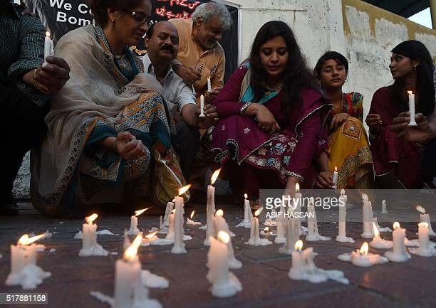 Pakistani Christians light candles as they stage a rally in Lahore on March 28 for victims of a suicide bomb blast Pakistan's army launched raids and...