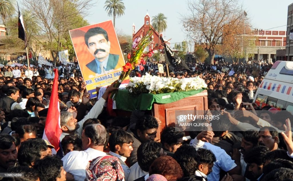 Pakistani Christians march carrying the coffin of slain Pakistani minister for minorities Shahbaz Bhatti during his funeral ceremony in his native...