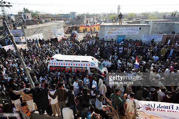 Pakistani Christians march with an ambulance carrying the coffin of slain Pakistani minister for minorities Shahbaz Bhatti during his funeral...