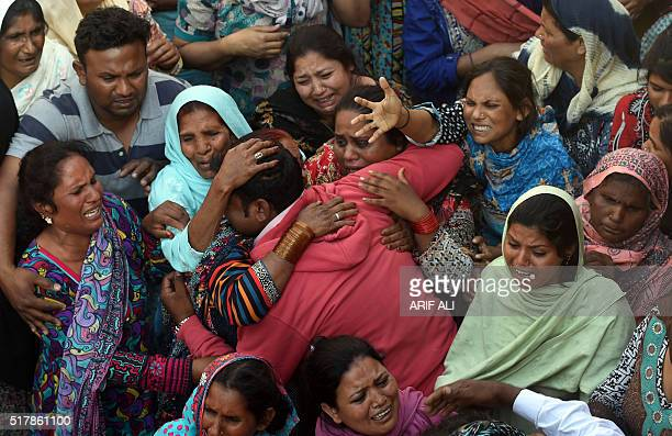 Pakistani Christians mourn as they attend a funeral for a blast victim of the March 27 suicide bombing in Lahore on March 28 2016 Pakistan's army...