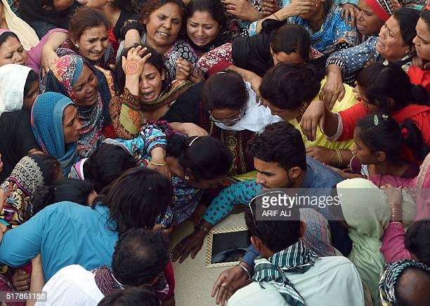 TOPSHOT Pakistani Christians mourn as they attend a funeral for a blast victim of the March 27 suicide bombing in Lahore on March 28 2016 Pakistan's...