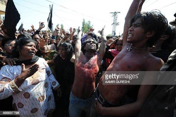 Pakistani Christians mourn as they beat their chest while shout slogans against the killing of slain Pakistani minister for minorities Shahbaz Bhatti...