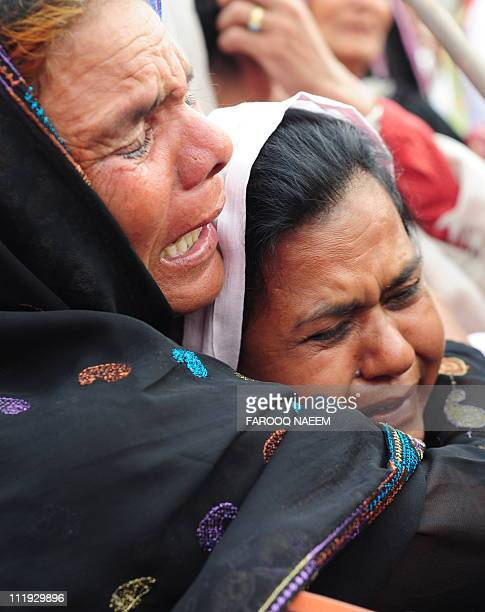 Pakistani Christians mourn the death of slain Christian minister Shahbaz Bhatti in front of parliament during special prayers in Islamabad on April 9...