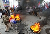 Pakistani Christians shout slogans beside burning tyres in protest against the killing by gunmen of Christian government minister Shahbaz Bhatti in...
