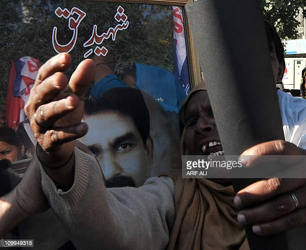 Pakistani Christians shout slogans in protest against the killing of slain Pakistani minister for minorities Shahbaz Bhatti in Lahore on March 11...