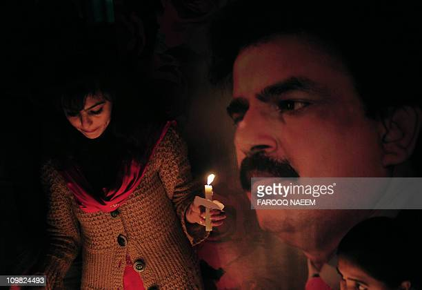 Pakistani civil rights activists light candles during a ceremony on the site of attack on slain Pakistani minority affairs minister Shahbaz Bhatti in...