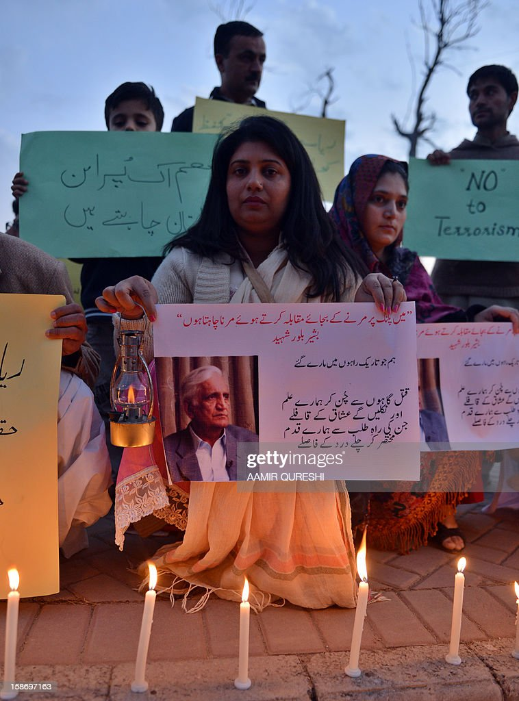 Pakistani civil society activists carry placards during a vigil for slain Pakistani provincial minister Bashir Bilour in Islamabad on December 24, 2012. Bilour, senior minister of northwestern Khyber Pakhtunkhwa province, was killed along with eight other people when the suicide bomber struck at a political meeting in the provincial capital Peshawar on December 22, 2012. AFP PHOTO/Aamir QURESHI