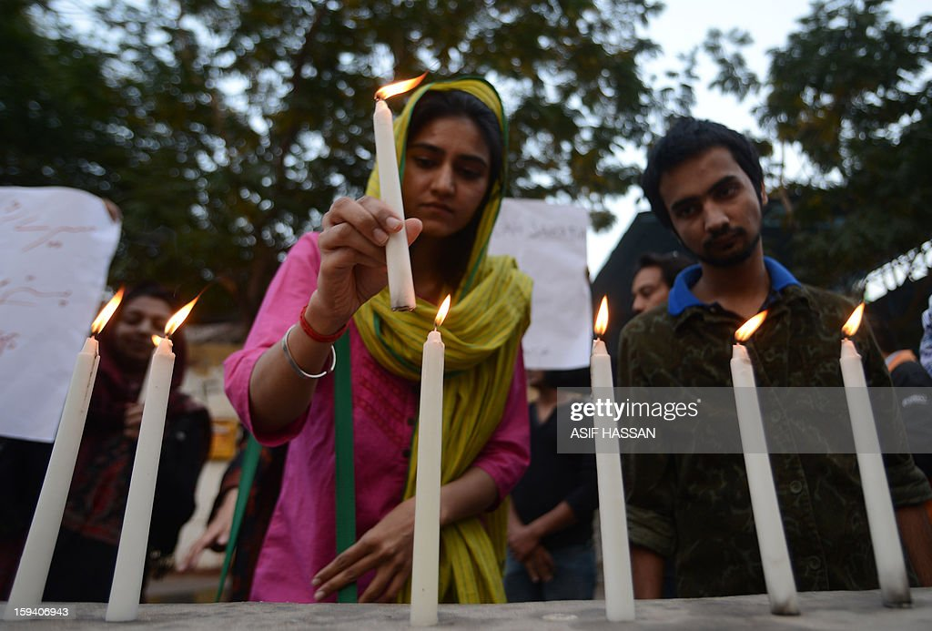 Pakistani civil society activists light candles against the twin bombings attack in Quetta, in Karachi on January 2013. Pakistan's Prime Minister Raja Pervez Ashraf arrived in the southwestern city of Quetta to meet Shiite Muslim families refusing to bury their dead after devastating bombings, officials said. AFP PHOTO/Asif HASSAN