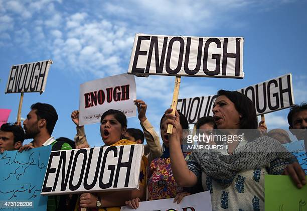 Pakistani civil society activists shout slogans during a against the killing of the Shiite Ismaili minority by gunmen in Karachi on May 13 2015...
