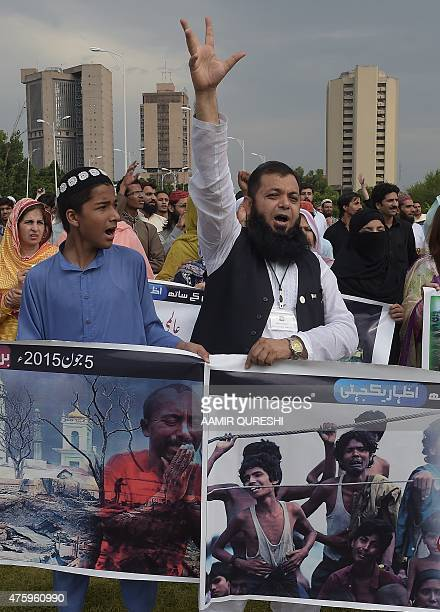 Pakistani civil society journalists and political party activists carry placards during a protest in support of Rohingya Muslims at a rally in...
