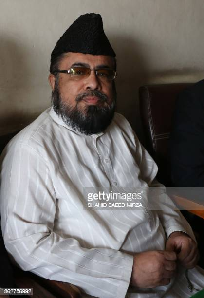 Pakistani cleric Mufti Abdul Qavi waits for his turn before his case hearing in the murder of a social media star Qandeel Baloch in Multan on October...