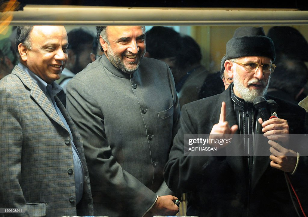 Pakistani cleric Tahir-ul Qadri (R) addresses his supporters from his makeshift room along with ruling party coalition leaders Qamar Zaman Kaira (C) and Babar Khan Ghauri (L) during a protest rally in Islamabad on January 17, 2013. Pakistani ministers held talks with a cleric leading a mass protest in Islamabad in an attempt to avert a political crisis and end a demonstration that has heaped pressure on the fragile government. AFP PHOTO/Asif HASSAN