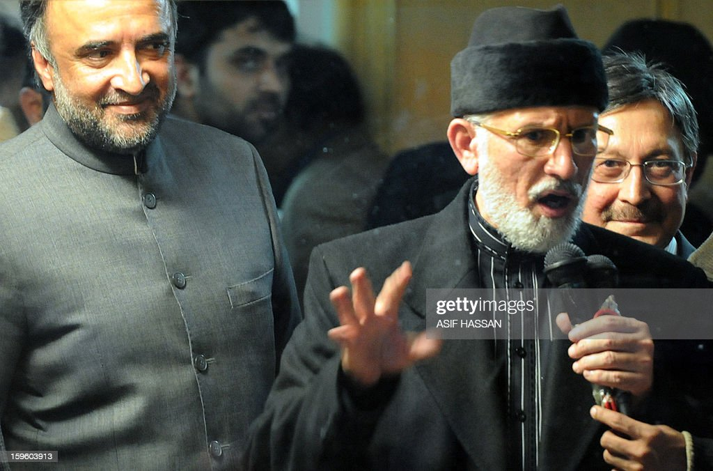 Pakistani cleric Tahir-ul Qadri (C) addresses his supporters from his makeshift room along with ruling party coalition leaders Qamar Zaman Kaira (L) and Farooq Naek (R) during a protest rally in Islamabad on January 17, 2013. Pakistani ministers held talks with a cleric leading a mass protest in Islamabad in an attempt to avert a political crisis and end a demonstration that has heaped pressure on the fragile government. AFP PHOTO/Asif HASSAN