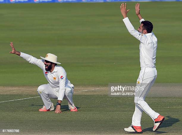 Pakistani cricket captain MisbahulHaq and teammate Mohammad Nawaz make a successful leg before wicket appeal against West Indies' batsman Kraigg...