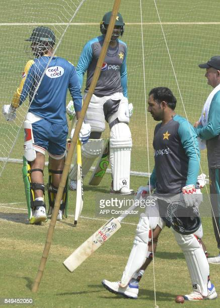 Pakistani cricket captain Sarfraz Ahmad and his teammates arrive for bat during a training session at the Gaddafi Cricket Stadium in Lahore on...