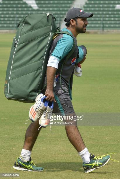 Pakistani cricket captain Sarfraz Ahmad arrives to attend a training session at the Gaddafi Cricket Stadium in Lahore on September 19 ahead of the...