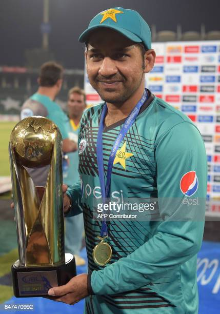 Pakistani cricket captain Sarfraz Ahmad holds the trophy after winning winning the third and final Twenty20 International match against World XI at...