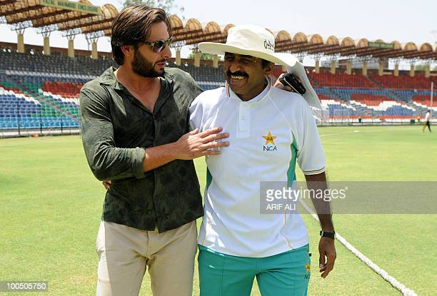 Pakistani cricket captain Shahid Afridi shares a light moment with Pakistani Cricket Board director Javed Miandad at The Gaddafi Stadium in Lahore on...