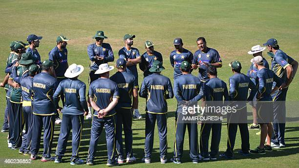 Pakistani cricket coach Waqar Younis speaks with players prior to the start of a practice session at the Sharjah cricket stadium in Sharjah on...