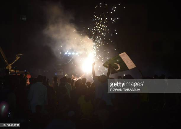 Pakistani cricket fans celebrate after the International Cricket Championship Champions Trophy final cricket match between Pakistan and India on June...