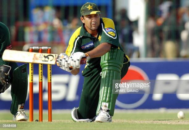 Pakistani cricket team skipper InzamamulHaq hits a boundary off Bangladeshi bowler Rajin Saleh during the third One Day International match between...