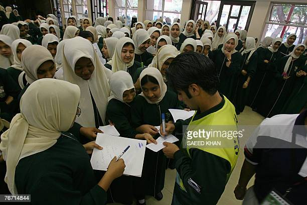 Pakistani cricket team vice captain Salman Butt gives autographs to students on the first day of the Islamic holy month of Ramadan at the Orient...