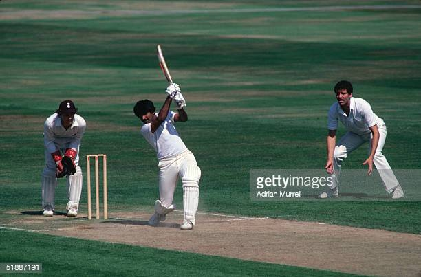 Pakistani cricketer Javed Miandad hits out during a match against Surrey August 1982