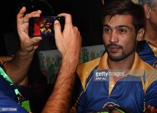 Pakistani cricketer Mohammad Amir poses for a photograph as he attends the drafting of players for the Pakistan Super League in Lahore on December 21...