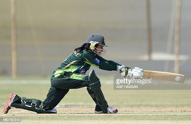 Pakistani cricketer Nida Dar plays a shot during the second T20 match between the Pakistan and Bangladesh women's cricket teams at The Southend Club...