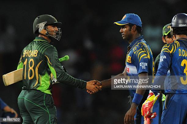 Pakistani cricketer Shoaib Malik is congratulated by Sri Lanka captain Angelo Mathews after their victory in the fourth One Day International match...