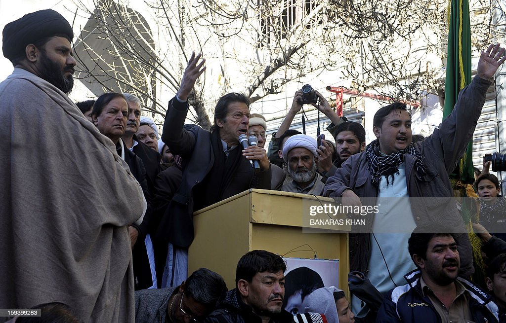 Pakistani cricketer turned politician Imran Khan (C) speaks to Shiite Muslim families who are refusing to bury their dead in Quetta on January 13, 2013, on the third day of protest. Pakistan's Prime Minister Raja Pervez Ashraf arrived in the southwestern city of Quetta to meet Shiite Muslim families refusing to bury their dead after devastating bombings. AFP PHOTO/ Banaras KHAN