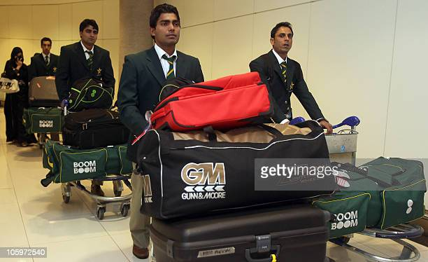 Pakistani cricketers arrive at Abu Dhabi airport on October 23 2010 Pakistan will play two Twenty20 five oneday internationals and two Tests against...