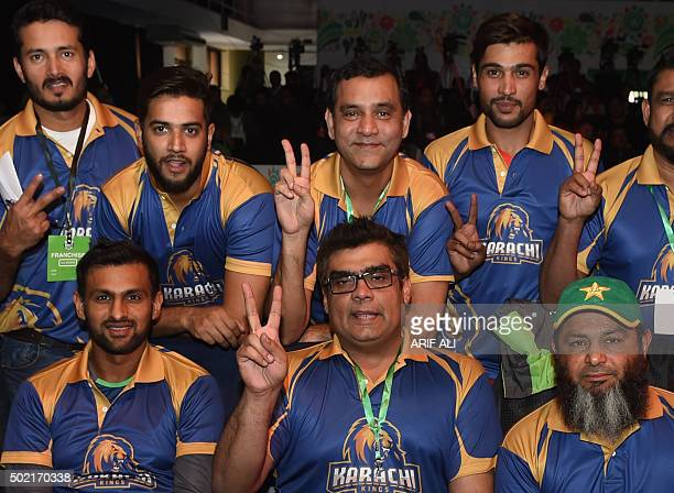 Pakistani cricketers from the Karachi Kings pose for a photograph as they attend the drafting of players for the Pakistan Super League in Lahore on...